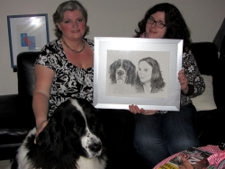 Dog Emma and Johanna presenting their portrait to a happy Mum.