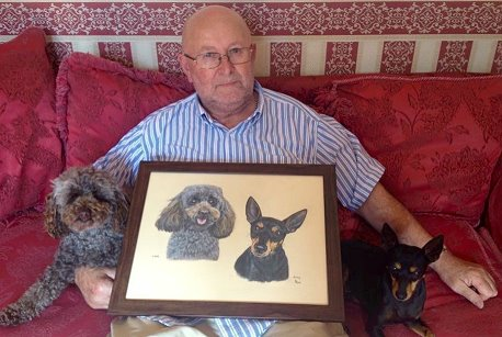 Mr Scull is very happy with the portrait of his dogs Lottie and Amy, a birthday gift.
