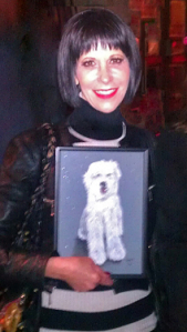 Actress Ellen Greene with the portrait of her