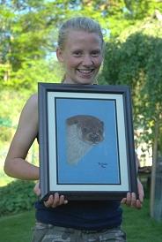British Wildlife Centre keeper Izzy with portrait of otter