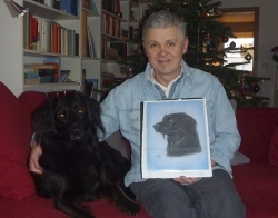 Maggie and her owner who was given her portrait as a Christmas gift.
