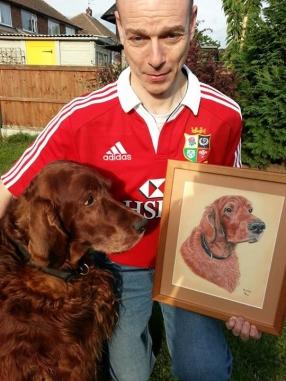 Irish Setter Murphy looking at his portrait.