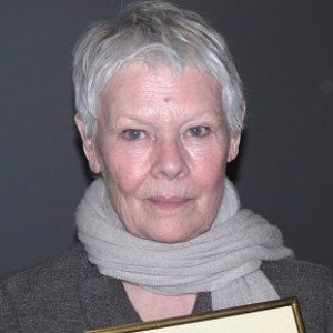 Dame Judi Dench with portrait