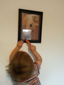 Little boy feeds his pony's portrait