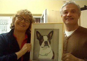 Boston Terrier Magic's owners with portrait