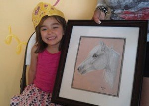 Little girl with pony portrait